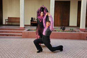 Female dancer and @albertossye in flamenco style positions.