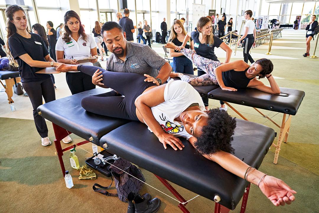 Dance Resource Center's Dancer Day of Health medical expert evaluating black female dancer.