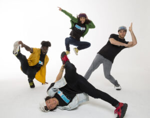 Breakdancers from @universoulhiphop posed on the ground and in the air.