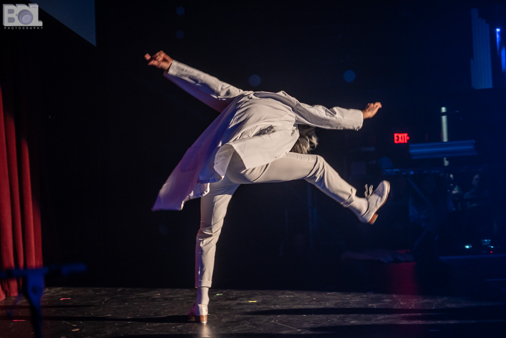 Male tap dancer in all white suit.