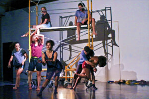 Dancers from @dance_aegis company performing among scaffolding set.