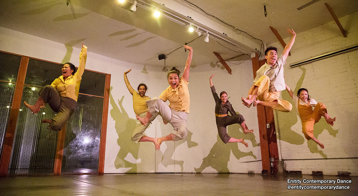 Dancers from @entitycontemporarydance jumping in the air.