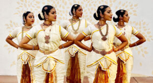Female @rangolidancecompany dancers posed looking to the right.