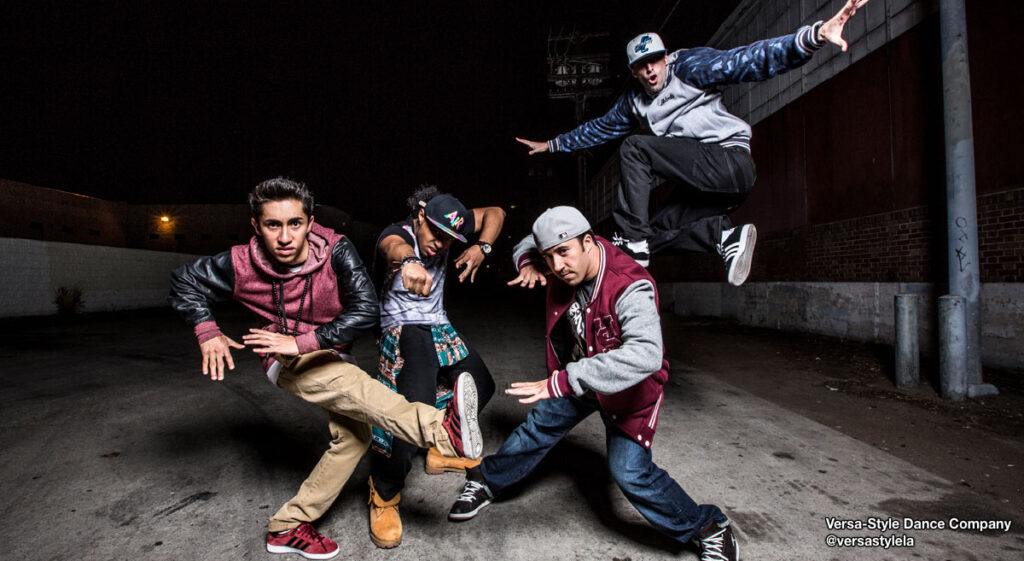 Four male hip-hop dancers from @versastylela posed on the street.