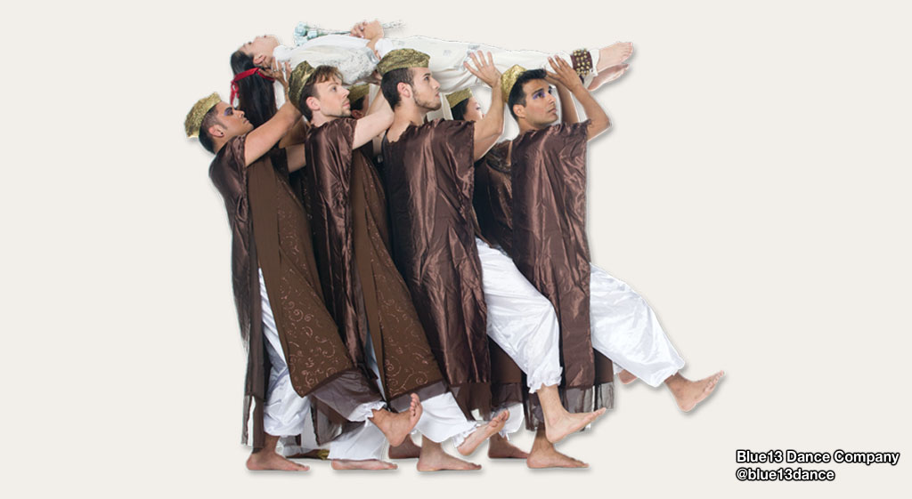 Group of male dancers from @blue13dance carrying another dancer horizontally.
